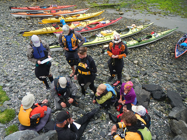 several sea kayak guides meeting